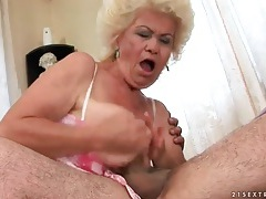 Granny gives his young dick a hot blowjob tubes