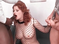 Gorgeous redhead sucks and fucks in interracial threesome tubes