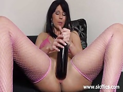 Amateur slut devours a wine bottle and monster dildo tubes