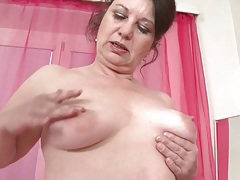 Mature fondles her big ass and saggy tits tubes