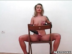 Tattooed and pierced blonde fingers her tight cunt tubes