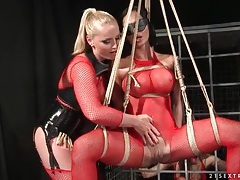 Lesbian submissive in lingerie and rope bondage tubes