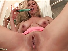 Mature plays with her tits and pussy in bathroom tubes