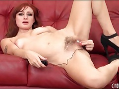 Redhead in high heels stuffs vibrator in her ass tubes