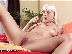 Sweet bleach blonde plays with her pussy tubes