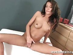 Brunette pours a glass of urine on her head tubes