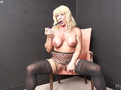Wildkat plays with her big clit tubes
