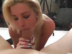 Skinny blonde on her knees sucking dick tubes