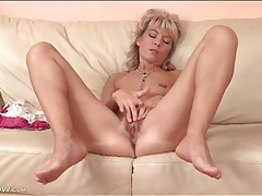 Cute mature blonde plays with her tight pussy tubes