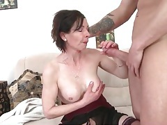 Mature blows thick young cock that fucks her tubes