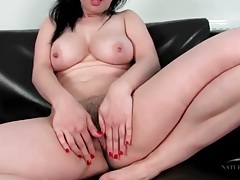 Hairy brunette plays with her pubic hair tubes