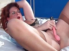 Masturbating mature redhead in sexy lingerie tubes