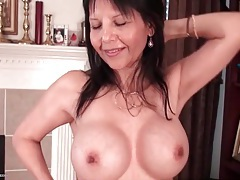 Hot mature fondles her big fake tits lustily tubes