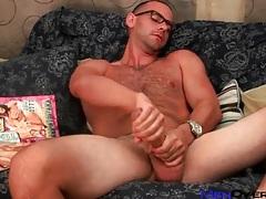 Hot hairy guy in glasses strokes big cock tubes