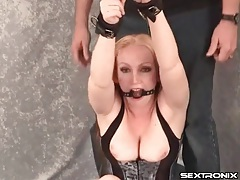 Bound and gagged milf in tight corset tubes