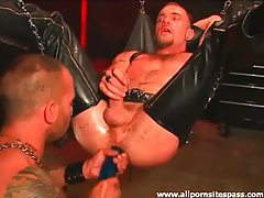 Leather dude in sex swing fucked by big cock tubes