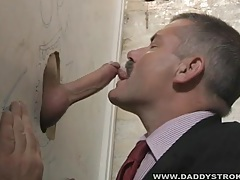 Mature daddy in suit sucks cock at the glory hole tubes