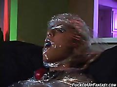 Blonde sex slave sucking on two huge cocks tubes