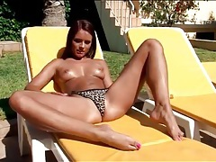 Young body in leopard print bikini outdoors tubes