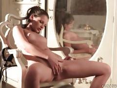 Skinny girl fingers her pussy in sunlight tubes
