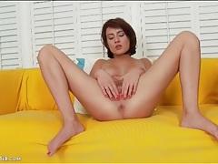 Brunette in tiny skirt finger fucks her pierced cunt tubes