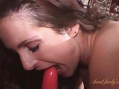 Pink dildo penetrates super cute brunette tubes