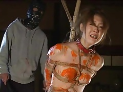 Bound beauty covered in wax and flogged tubes