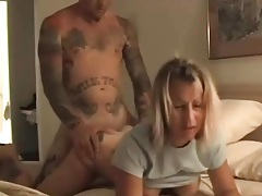 Heavily tattooed dude bangs blonde from behind tubes