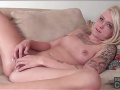 Young tattooed blonde masturbates shaved vagina tubes