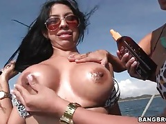 Curvy latina bikini girls oiled up on a boat tubes