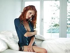 Gorgeous redhead strips and tenderly masturbates tubes