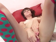 Young lady in super cute socks masturbates tubes