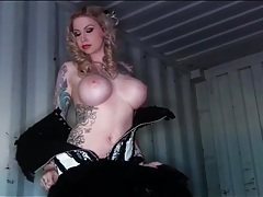 Heavily tattooed hottie strips off her sexy corset tubes