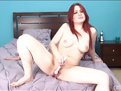 Redhead uses a little vibrator for her pussy tubes