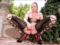 Blonde in sexy black lingerie fucks a toy tubes