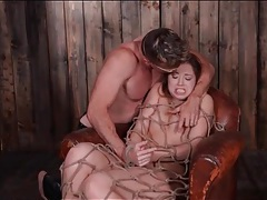 Cute girl bound by rope in his cabin tubes
