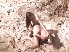 Naked lesbians fool around on the beach tubes
