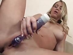 Blonde with great tits plays with her toy tubes