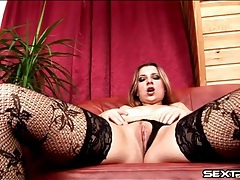 Sexy chick in stockings finger fucks her box tubes