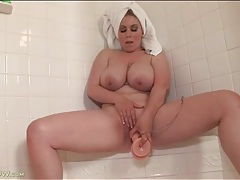 Big titty mom sits shaved cunt on a toy tubes