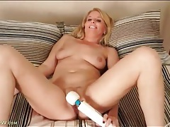Milf in satin lingerie masturbates with massager tubes