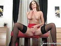 Pretty girl in black stockings plays with piss tubes