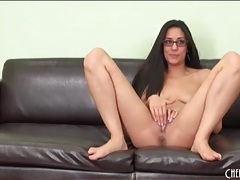Girl in boots and glasses finger fucks pussy tubes