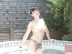 Topless milf looks sexy in the hot tub tubes