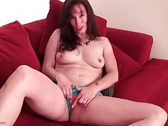 Mature brunette in pretty panties plays solo tubes