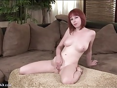 Pretty redhead shakes her booty in panties tubes