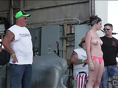 Roadie babes get wet dancing on a stage tubes