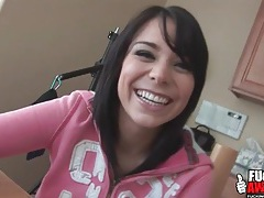 Cute porn chick chats as she eats lunch tubes