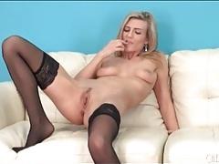 Leggy blonde lass in black stockings tubes