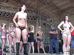 Topless ladies dancing on rock stage tubes